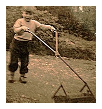 Will steps out with his first mower in Church Road Steep in 1956.
